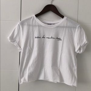 White cropped top with message on chest
